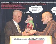 Überreichung der Anti-Duckmaus an Kretschmann als Ermahnung