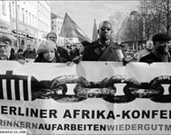 """Demonstration im Rahmen der Kampagne """"125 Jahre Berliner Afrika-Konferenz: erinnern, aufarbeiten, wiedergutmachen"""", 2009."""