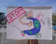 Demoschild - Braunkohlebagger frisst Erde auf